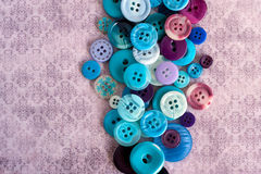Blue buttons on grungy background. Blue buttons on grungy wallpaper background Stock Images