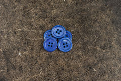 Blue buttons on the texture table Stock Photo