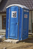 Blue cabin of a mobile bio toilet Royalty Free Stock Image