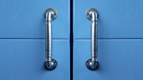 Blue cabinet doors with handles Royalty Free Stock Images