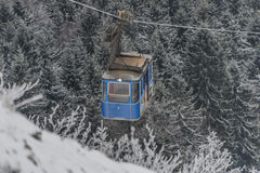 Blue cable car on Jested hill Royalty Free Stock Photo