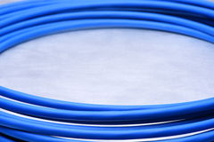 Blue cable on grey background Royalty Free Stock Photo