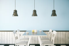 Blue cafe interior. Cafe interior with cake and two coffee cups on table, light blue wall and three ceiling lamps. 3D Rendering Stock Photo
