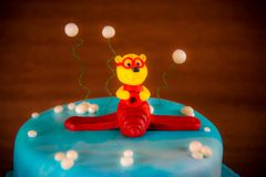 Cake decorated with plane and bear Stock Images