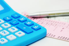 Blue calculator and billing. A blue calculator, pen, and billing Royalty Free Stock Photography