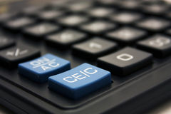 Blue calculator key closeup Stock Images