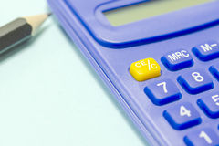 Blue calculator and pencil Royalty Free Stock Photo