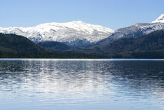 Blue Calm Lake and Snow Covered Mountain Stock Photos