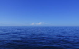 Blue calm ocean water. Calm open blue ocean water and sky Mediterranean royalty free stock photography