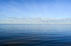 Calm blue sea and clear sky Stock Photos