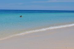 Blue calm sea with white sand Stock Images
