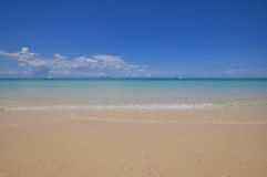 Blue calm sea with white sand. Blue calm sea clear water with white sand Royalty Free Stock Photography