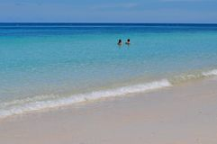 Blue calm sea with white sand. Blue calm sea clear water with golden sand Stock Image