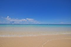 Blue calm sea with white sand. Blue calm sea clear water with golden sand Royalty Free Stock Photography