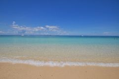 Blue calm sea with white sand. Blue calm sea clear water with golden sand Royalty Free Stock Photos