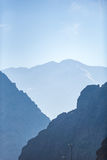 Blue calm sky above mountains Stock Images