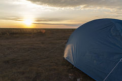 Blue Camping tent with sunset Concept: camping, travel, extreme Royalty Free Stock Image