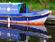 Blue canal boat Royalty Free Stock Images