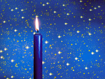 Blue candle. Over a starred background stock photo