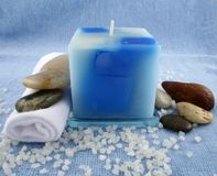 Blue Candle. A blue candle, a facecloth, stones and bath crystals Royalty Free Stock Images