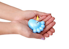 Blue candle for baby shower in hands Royalty Free Stock Photography