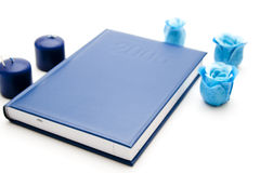 Blue candle with blue book Stock Photography