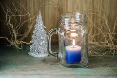 Blue candle in bottle glass Royalty Free Stock Photography