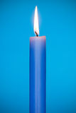 Blue candle burn Stock Photos