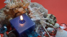 Blue candle with marine element stock video