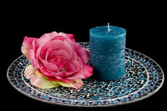 Blue candle with pink rose Stock Photo