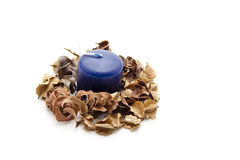 Blue candle with potpourri Royalty Free Stock Images