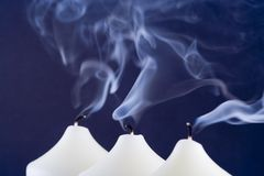 Blue Candle Smoke. Candles with blue smoke after being blown out Stock Image