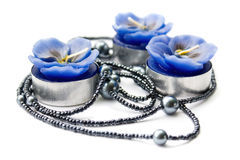 Blue candle with string of beads Stock Photography