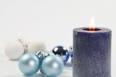 Blue candle and white background Royalty Free Stock Images
