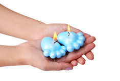 Blue candles for baby shower in hands. Isolated on white stock photo