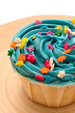 Blue Candy Cup Cake. A blue candy cup cake with colorful star toppings on a plate Royalty Free Stock Photo