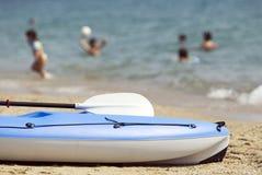 Blue canoe on a beautiful beach Royalty Free Stock Photography