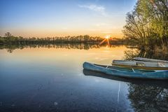 Blue Canoe and Body of Water Royalty Free Stock Photos