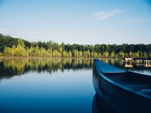 Blue Canoe on Body of Water during Daytime Royalty Free Stock Photos