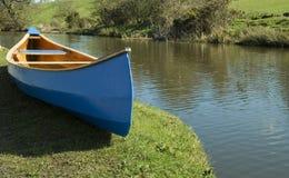 Blue canoe Stock Images