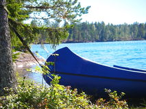 Blue canoe. At the shore of a swedish lake in summer Stock Images