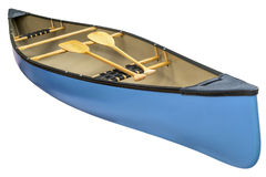 Blue canoe with wooden paddles royalty free stock photography