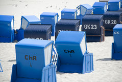 Blue canopied beach chairs at Baltic Sea. Lots of blue canopied beach chairs at Baltic Sea Royalty Free Stock Photos