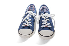 Blue canvas sneakers Stock Images