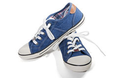 Blue canvas sneakers Stock Image