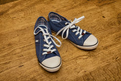 Blue canvas sneakers Stock Photos