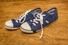 Blue canvas sneakers Royalty Free Stock Image