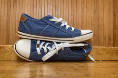 Blue canvas sneakers Royalty Free Stock Photos