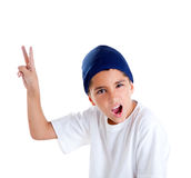 Blue cap kid boy with victory hand gesture Royalty Free Stock Photo