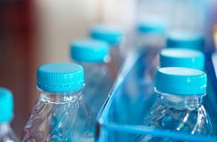 Blue cap water bottles. At restaurant Stock Images